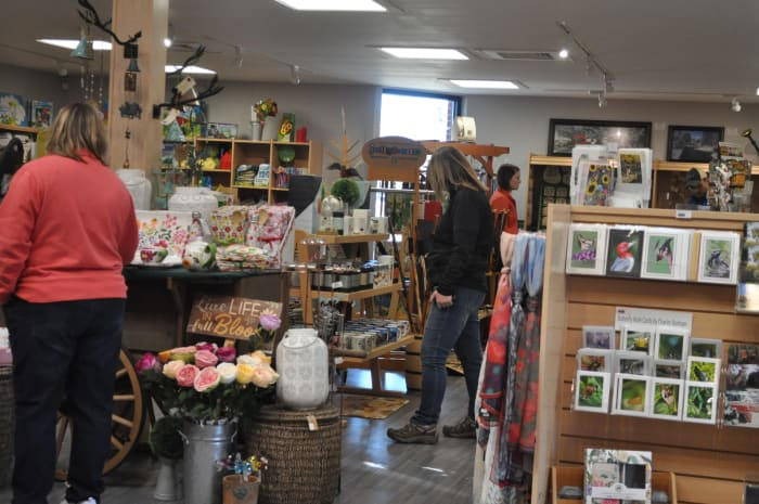 Note a variety of flower seeds for planting in the foreground.  The gift shop also features scented, home made candles and animal puppets for the kids.