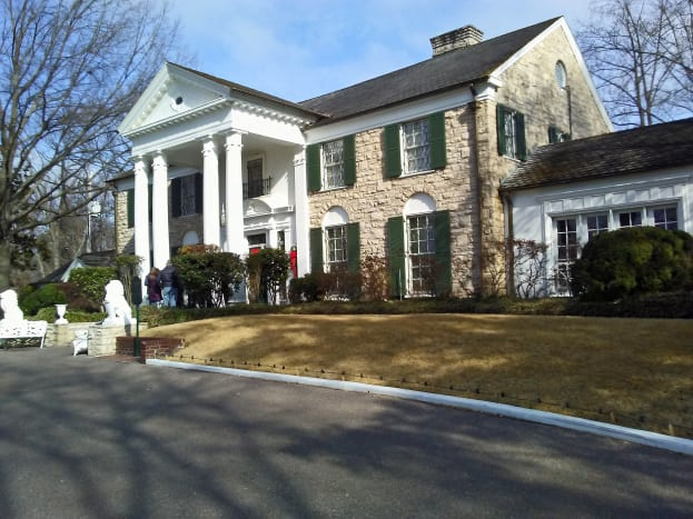The front entrance features two stone lions added by Elvis shortly after he purchased the house.