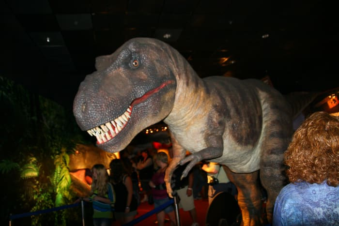 A life-sized T-Rex dominates the entrance to the dinosaur exhibit.