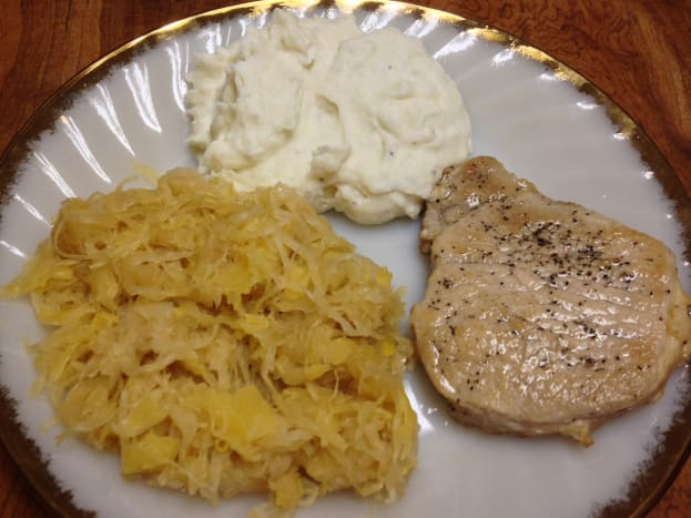 Meal with pork chop. Selenium can be found in lean meats, such as pork.