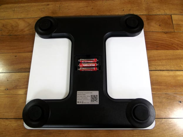 Underside of Arboleaf CS20N Smart Scale with battery compartment open