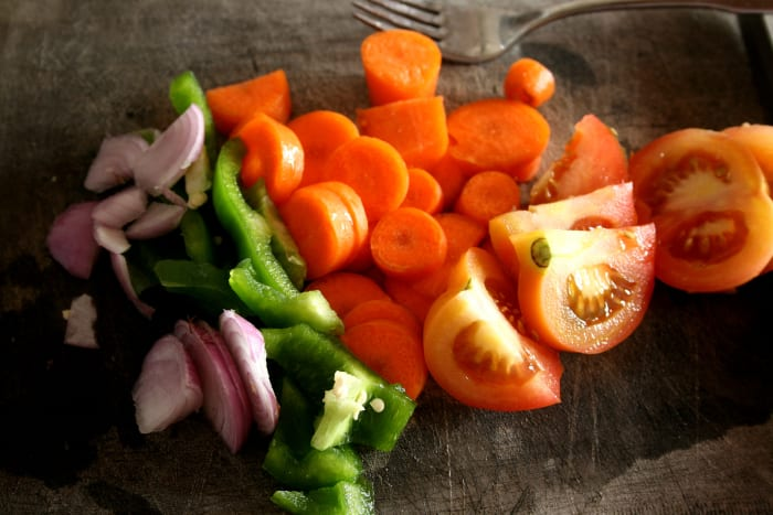 Research has found that people who eat a larger number of vegetables have lower rates of cancer.  Vegans have the lowest rates.