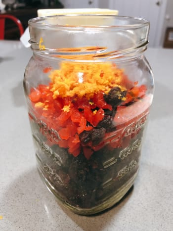 To soak the fruit mixture: In a jar, combine the dried fruits, glazed cherries, and orange zest.