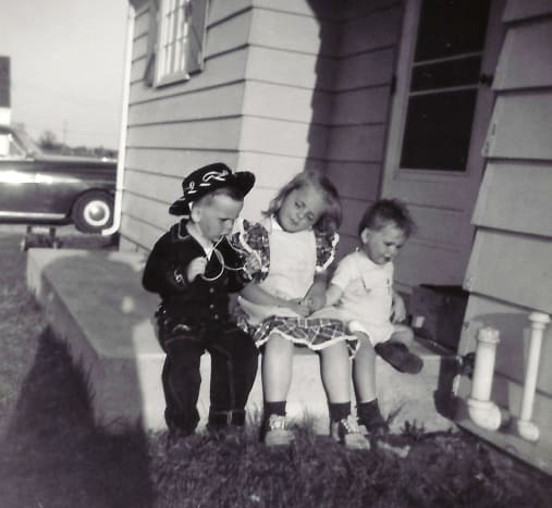 My brother John (in the cowboy outfit), me and my brother Jim.  Back then they were called Johnny and Jimmy.
