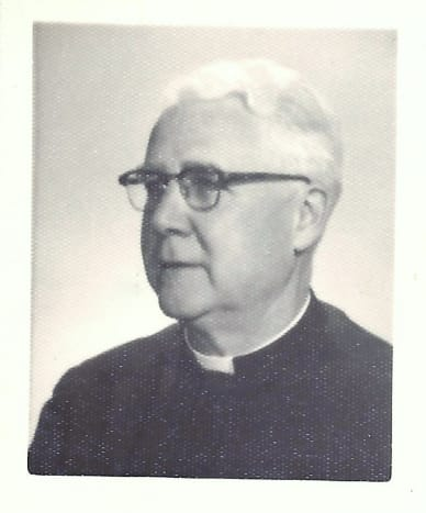 Father Whelan, the priest of St. Joan of Arc Catholic Church in Okauchee, Wisconsin.
