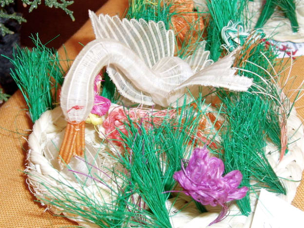 Chile used the most unique materials. This swan is made from dyed horsehair. It comes from a cooperative in Rari, Chile, which is renowned for its miniature horsehair weavings.