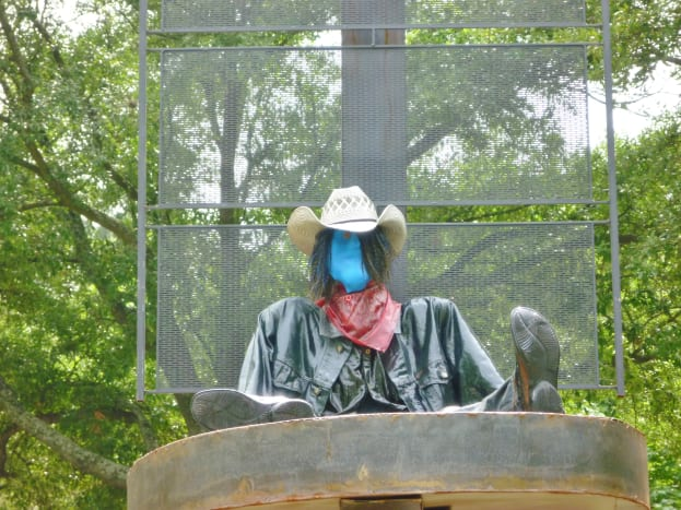 """Closeup of """"Retired Cowboy Clown"""" sculpture by Hans Molzberger in True South sculpture exhibition in Houston"""
