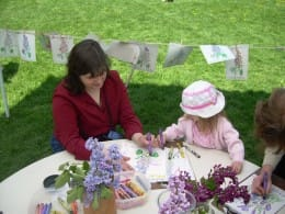 Mother and Daughter coloring  together on Lilac Sunday at the Arnold Arboretum