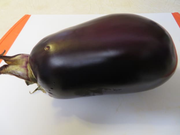 One large globe-shaped eggplant