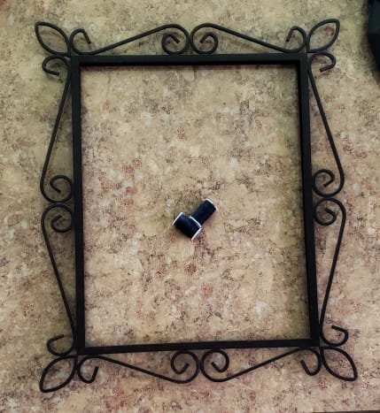 Start with an old picture frame and thread.