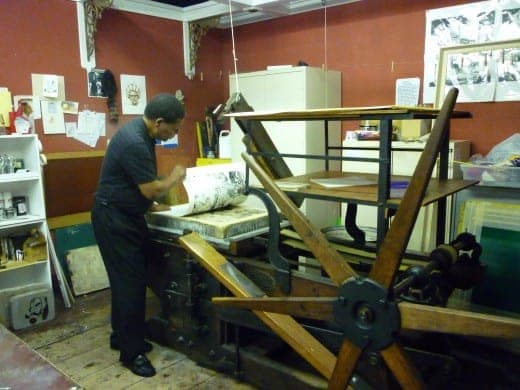 Here, Charles is pulling a lithography print off of a starwheel press from 1830.