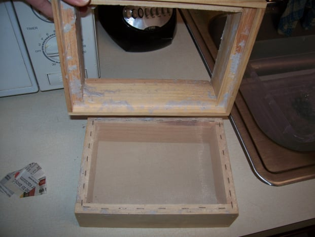 Step 1: See the two parts of the deckle, the larger part is the top.