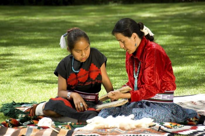 Navajo woman and girl, sharing culture.