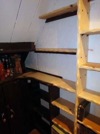 Two replacement wall shelves, test fitted with the other shelving positioned.