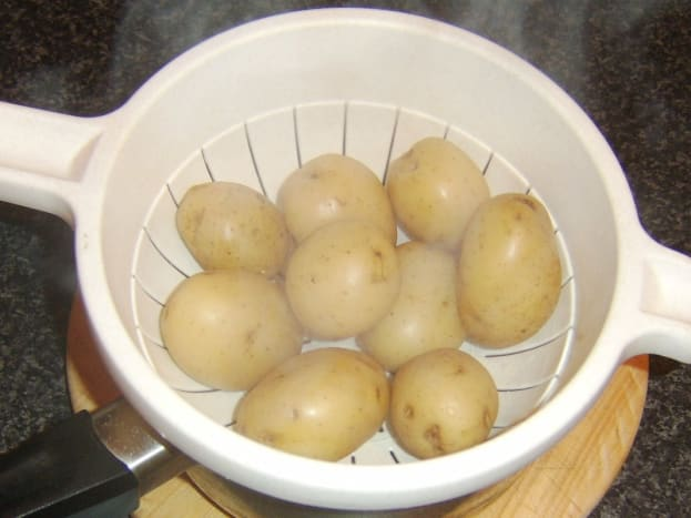 Boiled potatoes are drained and allowed to steam for five minutes