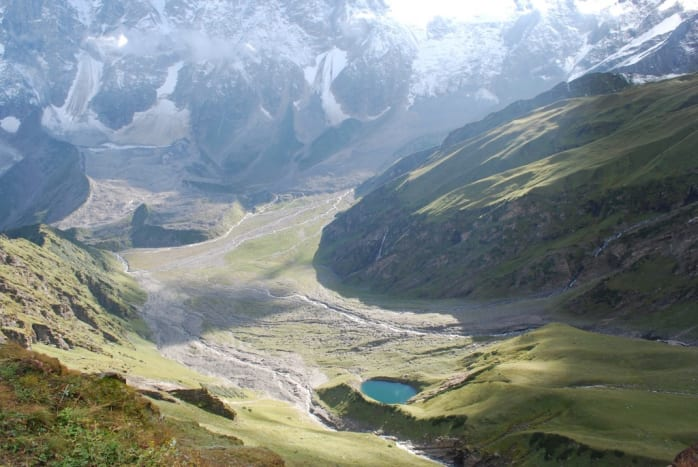 A view of beautiful blue Beas Kund or lake formed from the many streams from the Beas glacier before becoming Beas River