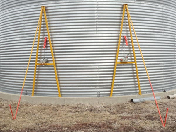 These are A-frame grain bin jacks with electric winches. Hand-crank models are sometimes used.