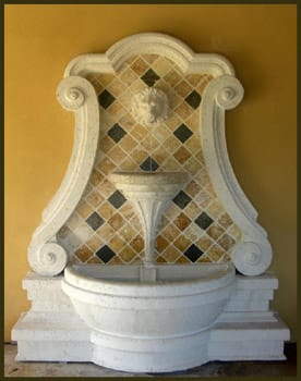 carved stone and yellow and brown tiles set the stage for this water fountain