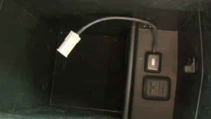 The Honda Civic's built-in iPod adapter is located at the bottom of the console.