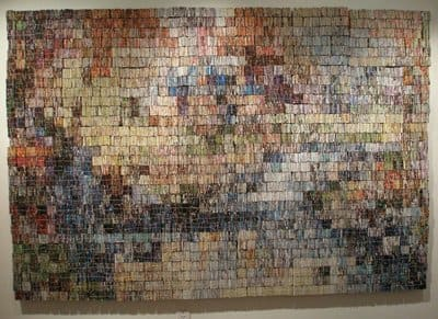 This piece is 8 ft x 5 ft and includes about 40,000 pieces of junk mail.