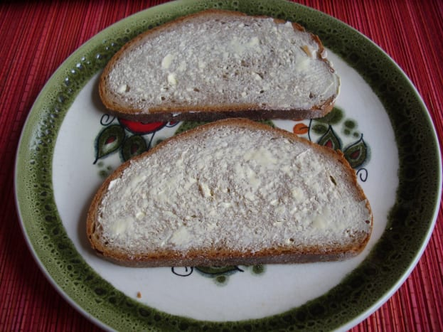 Slices of Graubrot spread with margarine.