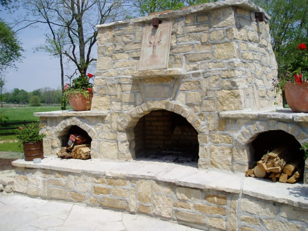 triple sectioned fire place expansive raised hearth with cavities on both sides for storing wood