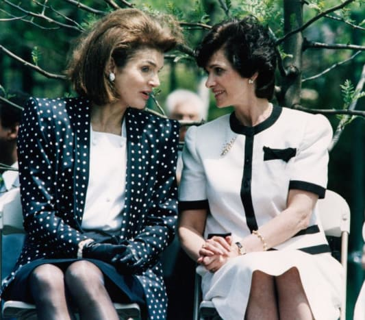 Jackie Kennedy and a friend - Jackie is wearing black gloves