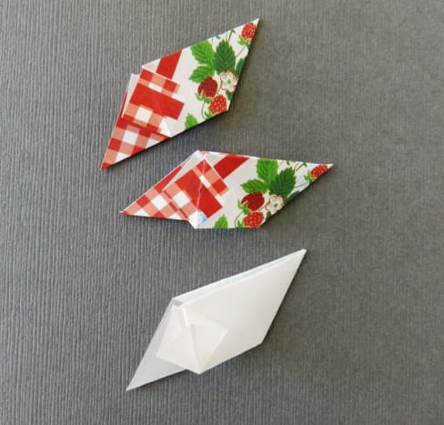 Fold two squares of your pattern and a square of vellum for the template.