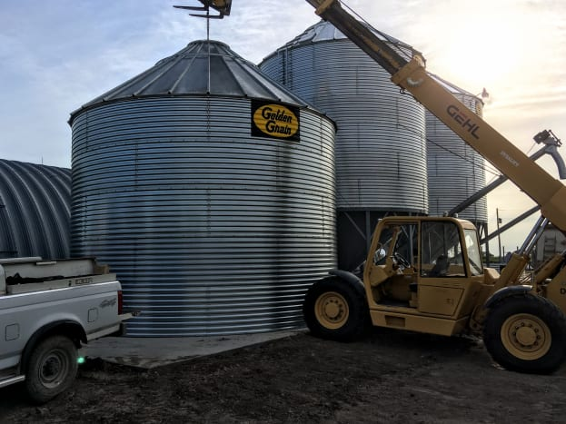 What you use to lift your bin may depend on what is available on your worksite. On this job, we had access to a large forklift and skilled operator, provided by the bin owner.
