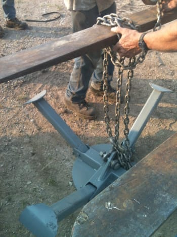 The lifting ring is chained to the boom of your crane or other lifting vehicle. Experiment with your chaining method so you can work out whatever results in the most balanced, secure combination of hooks, bolts, and chain wraps.