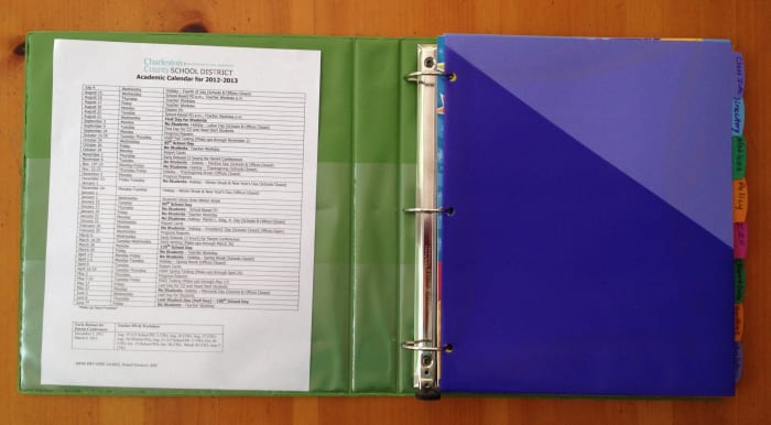 Colored dividers with tabs help keep forms and papers organized.