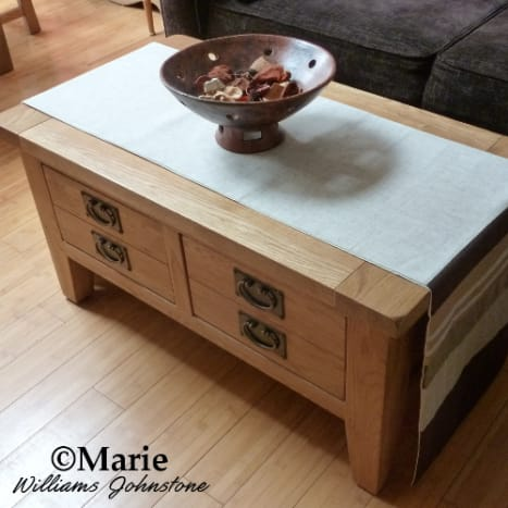 We choose a large oak coffee table with two big and deep drawers. One holds all my craft ribbons and the other has fabric.