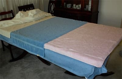To prepare your tabletop or other flat surface (I have used a twin bed and done it for a day instead of overnight.),you will need some very thick and thirsty cotton towels. Put them on top of a waterproof table cover or vinyl tablecloth.