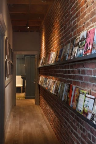 I love this idea.  Use long shelves to create a display space for books.