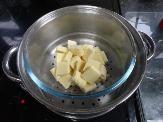 White chocolate for the filling being melted in the steamer