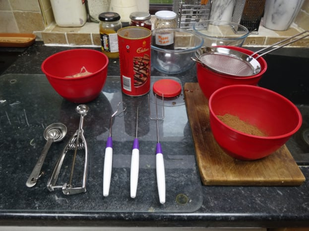 The mini scoop and 3 piece dipping set for chocolate making laid out on the work surface and ready for use