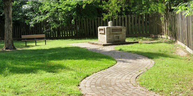 Paved path to the Tri-County Marker in Thomas Park