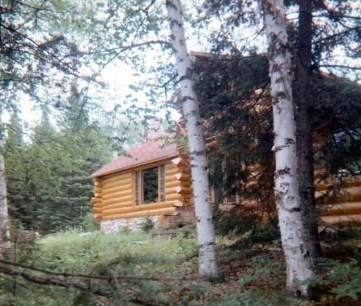 Partial view of front of Hibbard's log cabin in Ely, Minnesota
