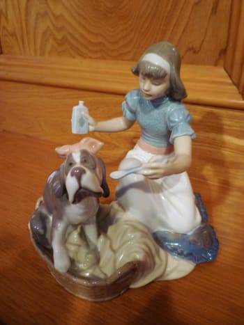 Lladro porcelain with girl ministering to a dog