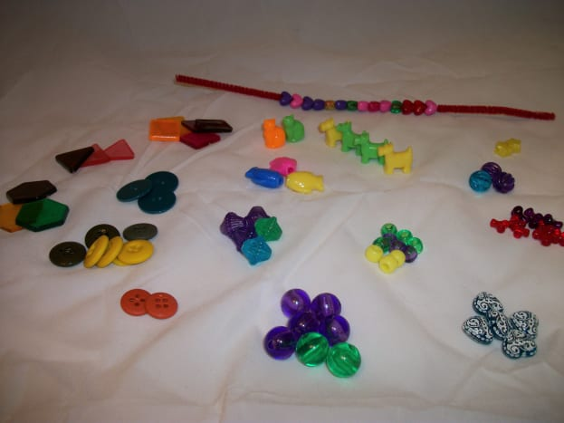 Miscellaneous buttons, beads, and Lucite shapes for sorting