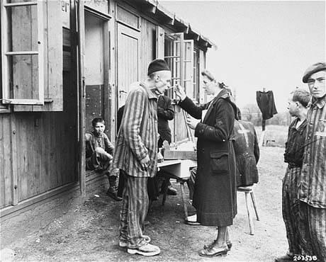 German Red Cross worker helps a survivor.