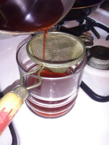 Once you have allowed your tea to steep, you are ready to strain your tea. You can use a small sifter like shown. Or cheesecloth will work as well. This is simply to remove any large pieces from your tea.