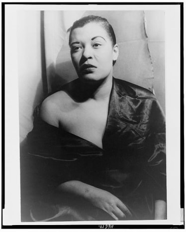 Famous singer Billie Holiday in 1949, with tight, smoothed hair.