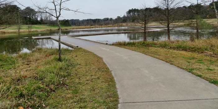 Approaching the raised boardwalk area over a pond in Keith-Wiess Park