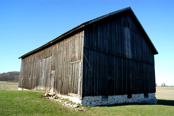 Many old barns were painted red or white.  Others, such as this simple, yet beautiful, barn were left natural.