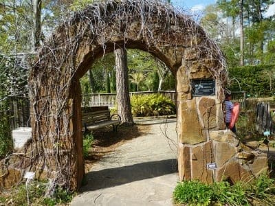 Archway marking the location of the endangered species garden at Mercer Arboretum