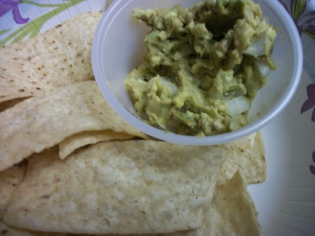 Guacamole made with avocado with chopped sweet onion