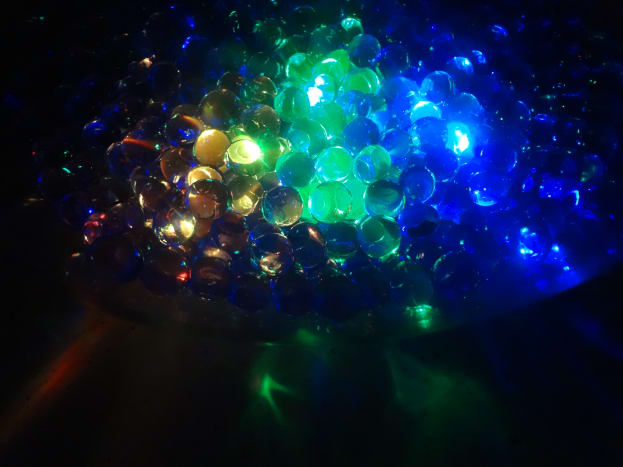Submersible LED lights in a vase of water beads.