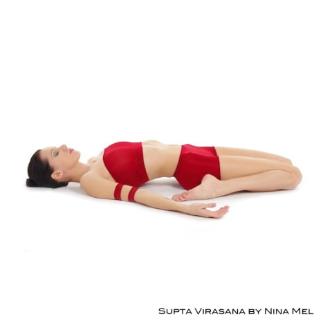 Supta virasana or reclining hero pose is a supine back bending yoga pose.