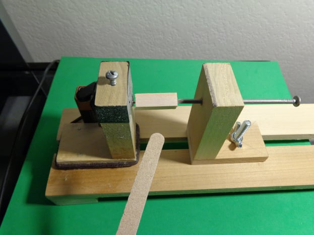 Balsa Wood centered on Mini Balsa Wood Lathe in preparation for turning.